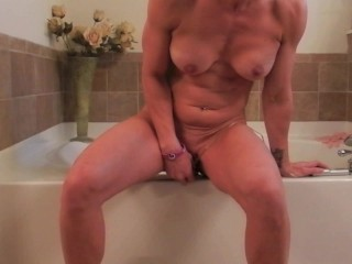 Hot Housewife masturbates with huge dildo attached to tub