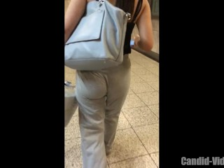 Sexy candid jiggly ass girl walking in soft grey pants