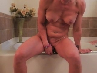 Hot girl masturbates with huge dildo attached to tub