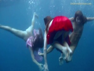 Hot erotics in the sea with 3 girls