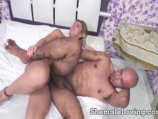 Blonde shemale and a horny guy are on the bed fucking each other's asses