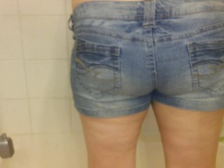 Danielle Pees in Jean Shorts in the Shower