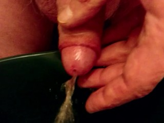 Playing with my piss and cum.